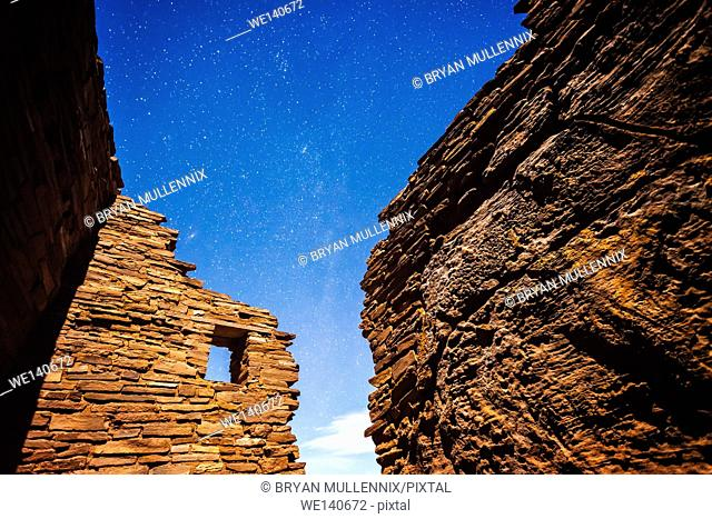 Stars in the sky at night above an 800 year old native american pueblo in northern Arizona