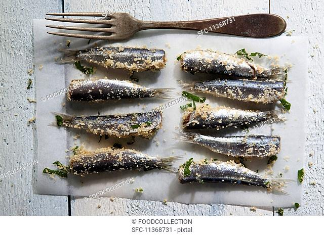 Sardines coated with breadcrumbs and parsley