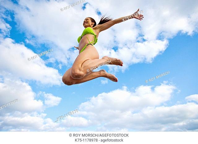 Woman in bikini, jumping