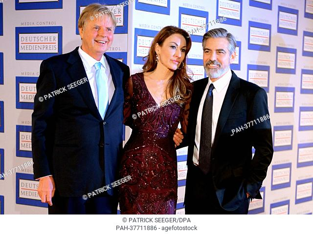 US actor George Clooney (R) poses with Karlheinz Koegel (L) of Media Control and Koegel's wife Dagmar during the presentation of the German Media Prize 2012 at...
