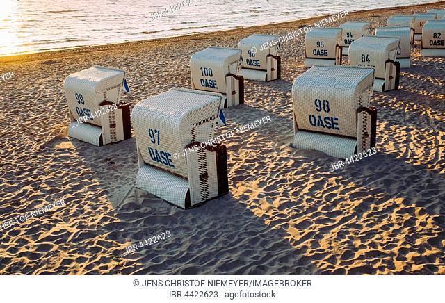 Beach chairs with long shadows, Scharbeutz beach, Schleswig-Holstein, Germany