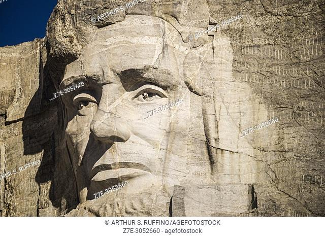Close-up of granite sculpted face of President Abraham Lincoln. Mount Rushmore National Memorial, Black Hills, Keystone, South Dakota, U. S. A
