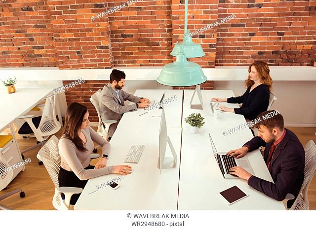 Group of executives working at desk
