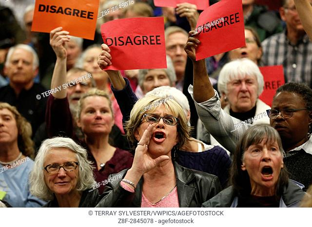 Participants criticize U. S. Rep. Greg Walden (R-OR) during a constituent town hall meeting on April 13, 2017. Bend, Oregon, United States