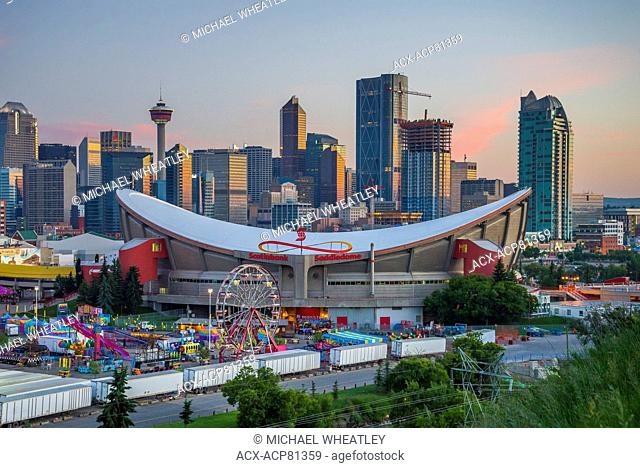 The Stampede Midway, Saddledome and Calgary skyline, Calgary, Alberta, Canada