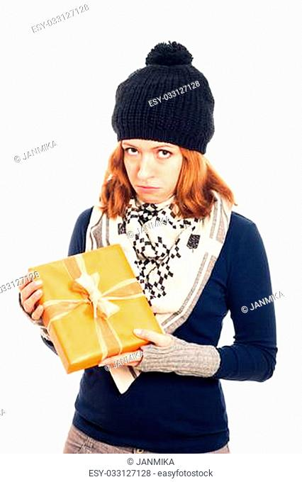 Unhappy disappointed sad woman holding gift box, isolated on white background