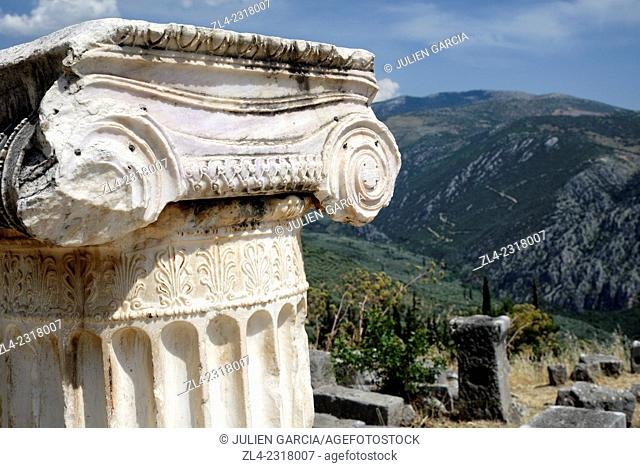 Ionic column fragment in the sanctuary of Apollo. Greece, Central Greece, Sterea Ellada, Phocis, Ancient Delphi, listed as World Heritage by UNESCO