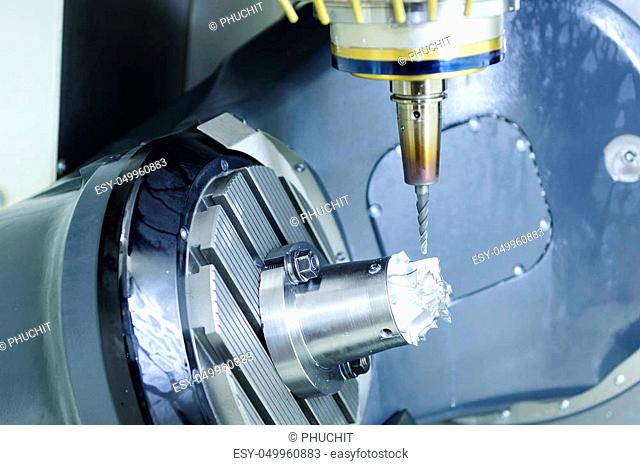 The five-axis Computer Numerical Control (CNC) machine while cutting sample aerospace part, turbine in the light blue scene