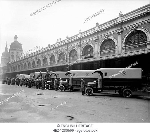 Delivery lorries at Smithfield Market, London, 1915. Three delivery lorries and seven delivery waggons for Danish Bacon, with their drivers