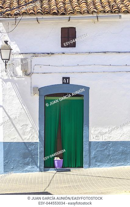 Popular architecture at extremaduran-portuguese boundary rural area called A Raia or Raya. Door with courtains and bucket