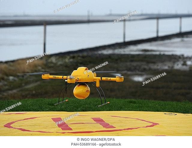The new DHL 'Paketkopter' drone delivery service begins its flight with medicine over to the island of Juist from Norddeich, Germany, 18 November 2014
