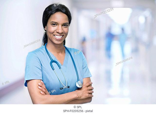 Female doctor smiling towards camera
