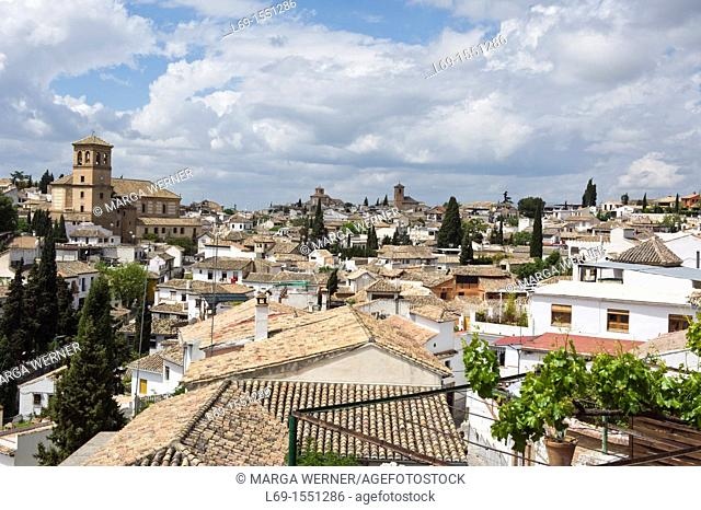 View over the rooftops of Sacromonte with Salvador church and church San Cristobal, Granada, Andalusia, Spain