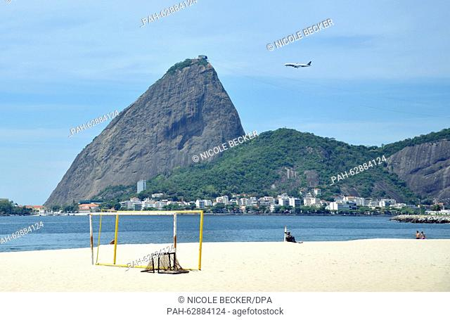 View of Flamengo beach and the Baia de Guanabara in Rio de Janeiro, Brazil, 08 October 2015. In the background a plane flies past the sugarloaf mountain on the...