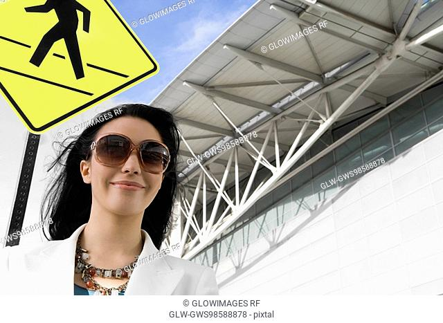 Low angle view of a businesswoman smiling at an airport