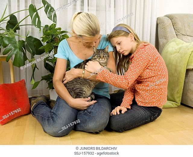 woman and girl with domestic cat