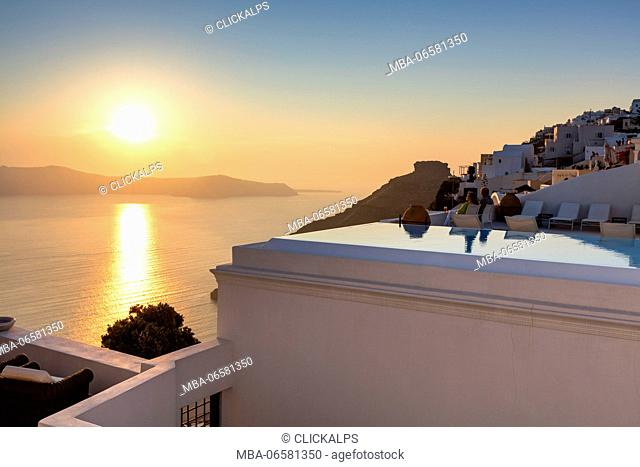 Sunset over the Aegean Sea seen from the old village of Firostefani Santorini Cyclades Greece Europe