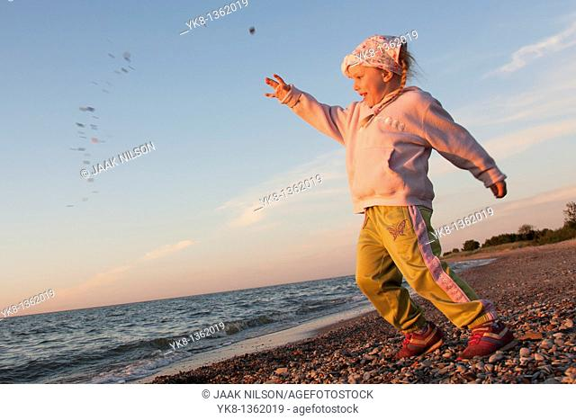 Young Girl Throwing Stone into Water