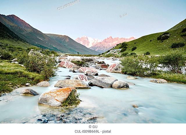 Mani stone in river, Dege, Sichuan, China