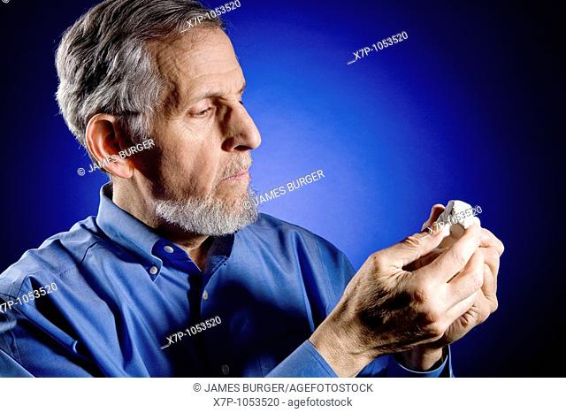Sculptor Inspecting Clay on Blue Background