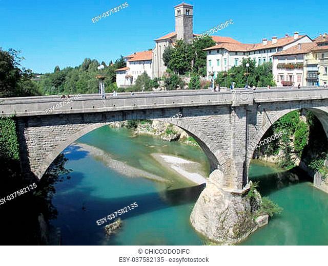breathtaking majestic arched bridge says Devil's bridge in cividale