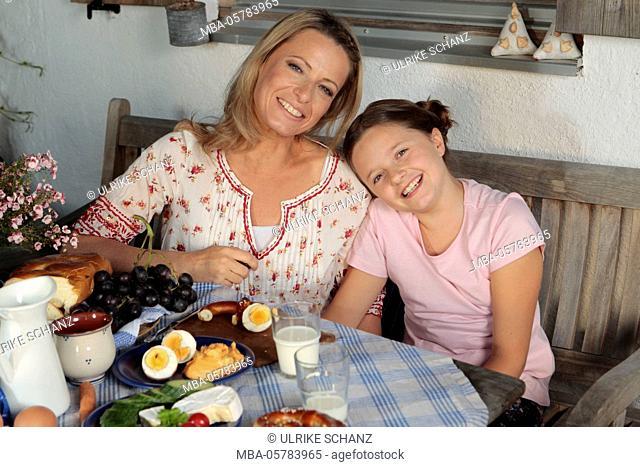 Mother, daughter, terrace, sitting, snack, half portrait
