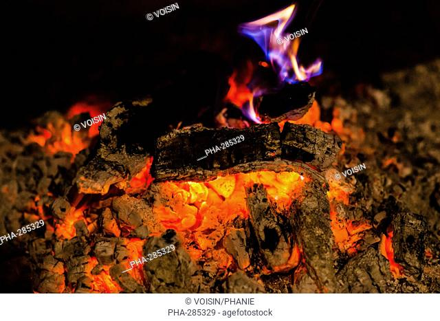 Flames and glowing embers in a fire