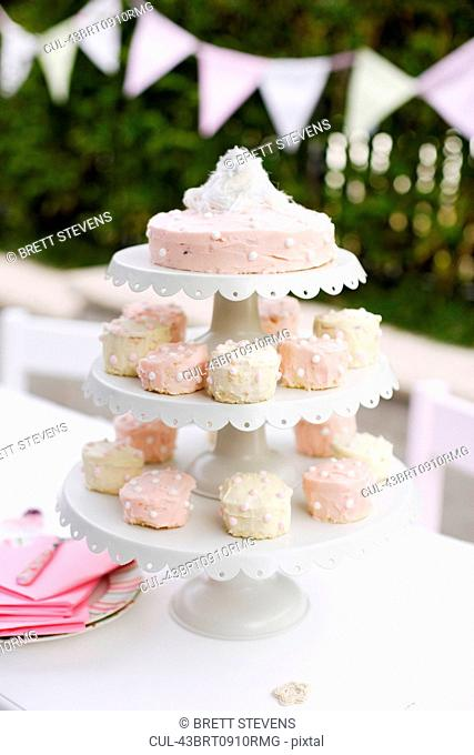Tiered platters of cupcakes and cake