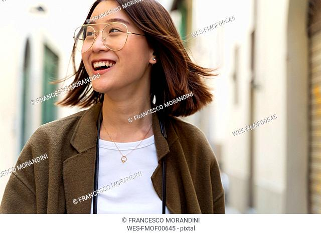 Italy, Florence, happy young woman in the city