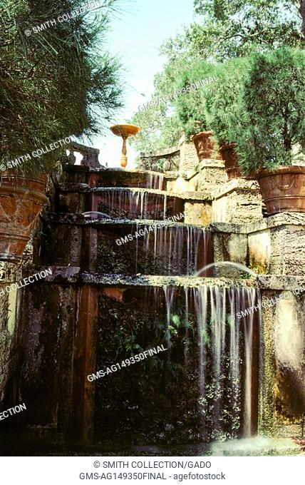 Waterfall and decorative carvings in Fairchild Garden, Miami, Florida, 1985