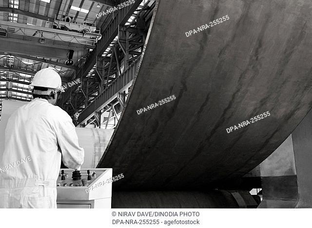 worker operating plate bending machine, mumbai, maharashtra, India, Asia