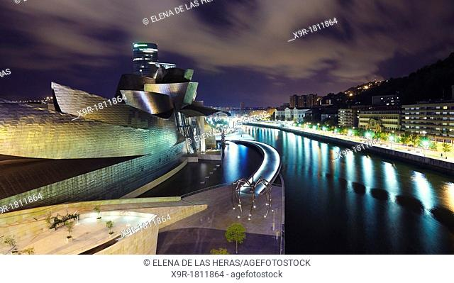 Panoramic night view from La Salve bridge of Guggenheim museum and River Nervion, Bilbao, Biscay, Basque Country, Spain