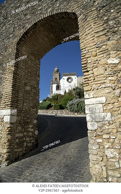 Church of Saint Mary the Crowned seen through the Arco de Belen in Medina-Sidonia, Andalusia, Spain