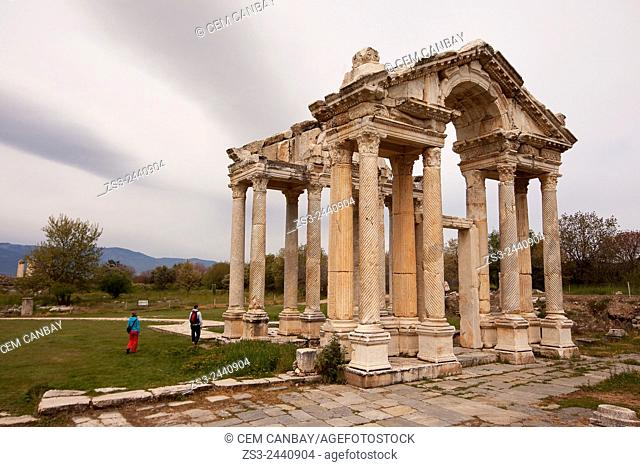 Tourists at the antique Tetrapylon in the ancient ruins of Aphrodisias, Aydin Province, Aegean Coast, Turkey, Europe