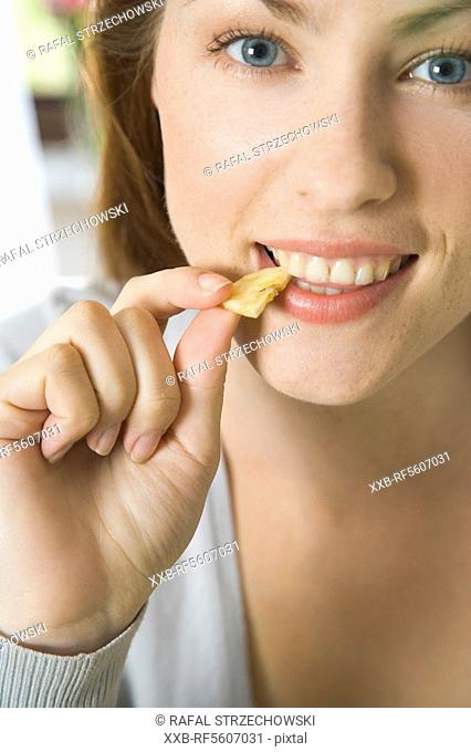 woman eating croissant