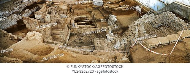 looking down from the highest point of the south area across the Neolithic remains of mud brick houses walls. In the centre it can be seen how deep the...