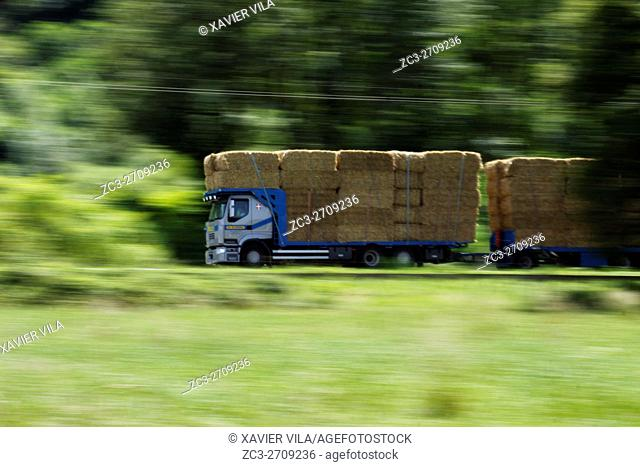 Truck with straw bales driving on the road to the Savoy.Chartreuse, Isere, Rhone Alpes, Alps, France