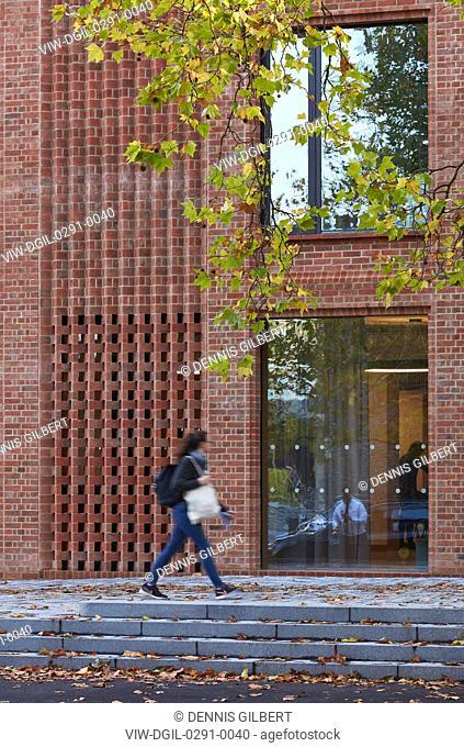 Figure moving along entrance facade. Newnham College, Cambridge, Cambridge, United Kingdom. Architect: Walters and Cohen Ltd, 2018