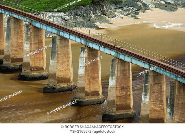 Kaaimans River on the Garden Route in the Western Cape Province of South Africa. The old railway bridge (now abandoned) runs across the river mouth on the beach