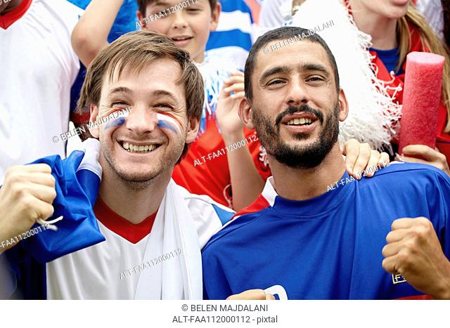 French football supporters at match, portrait