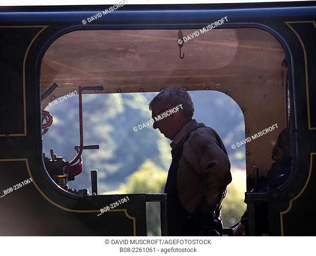 driver and fireman prepare a locomotive at Peak Rail Steam Railway at Matlock, Derbyshire, UK