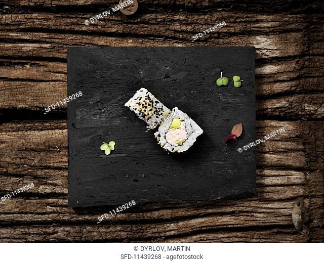Uramaki with crab, avocado and sesame seeds