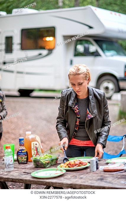 Woman preparing food at RV campsite