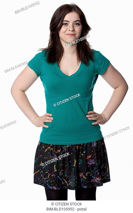 Smiling Caucasian woman with hands on hips