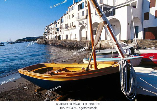 Boat in Port Alguer beach and Riba Pitxot in background. Cadaques. Alt Emporda. Girona province. Catalonia. Spain