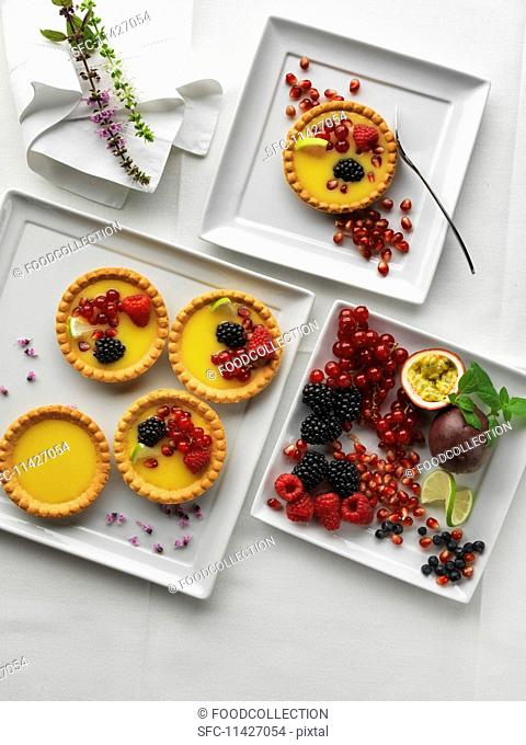 Tartlets with berries on a square plate