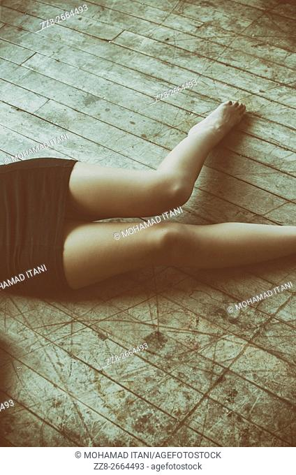 Close up ofa dead woman body on the floor