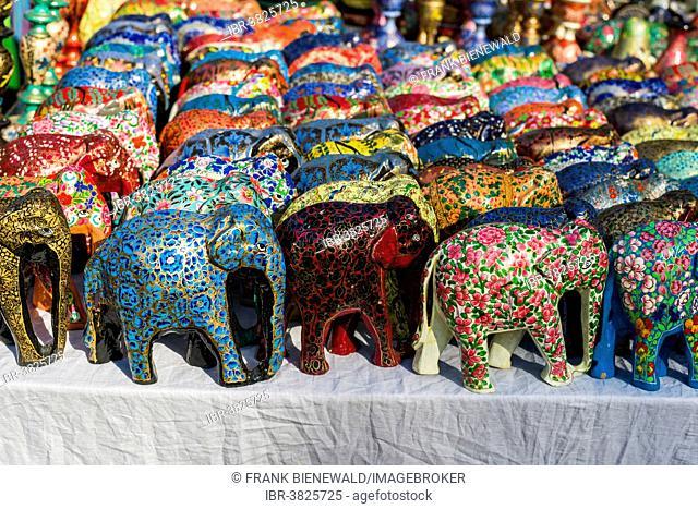 Colourful papier mâché elephants for sale at the weekly flea market, Anjuna, Goa, India