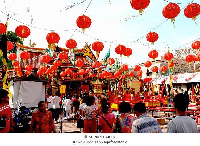 Thailand Phuket Phuket Town People queue to enter the Hock Nguan Kong Shrine at Chinese New Year