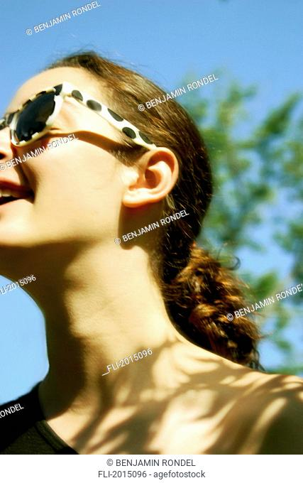Teenager Laughing Wearing Sunglasses